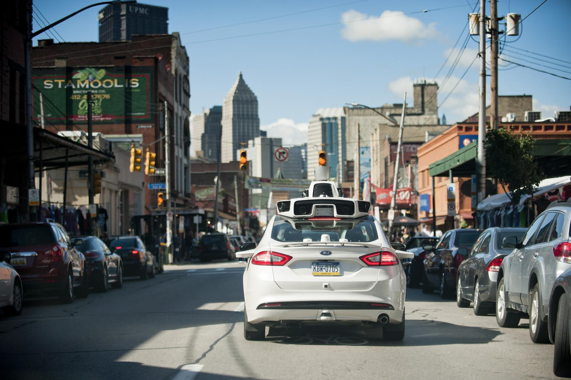 Uber's self-driving car drives through the city for mapping and topography purpose.